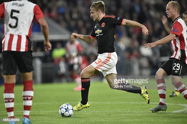 Manchester's Luke Shaw vies with PSV Eindhovens midfielder Jorrit Hendrix during the UEFA Champions League Group B football match between PSV...