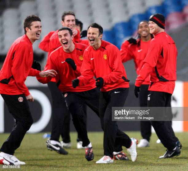 Manchesters United players Michael Carrick John O'Shea Ryan Giggs and Wayne Rooney during a training at the Stade Gerland in Lyon France