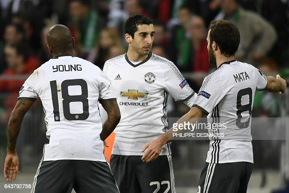 Manchester's United's Armenian forward Henrikh Mkhitaryan celebrates with teammates Spanish midfielder Juan Mata and British midfielder Ashley Young...
