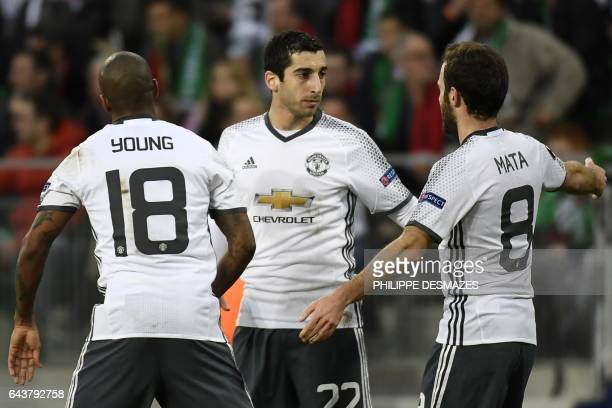 Manchester's United's Armenian forward Henrikh Mkhitaryan celebrates with teammates Spanish midfielder Juan Mata and British midfielder Ashley Young...