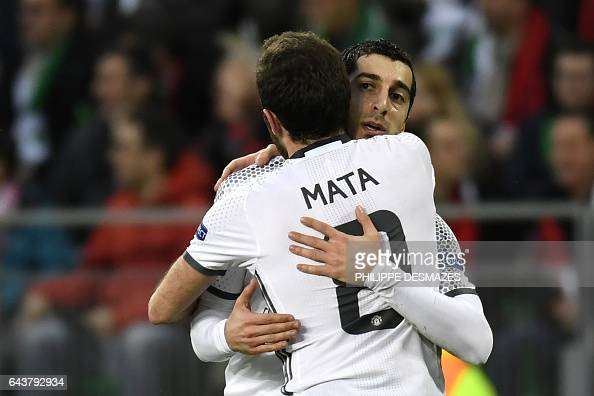 Manchester's United's Armenian forward Henrikh Mkhitaryan celebrates with teammate Spanish midfielder Juan Mata after scoring a goal during the UEFA...