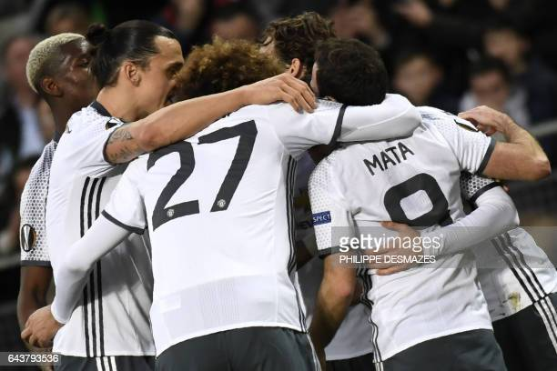 Manchester's United's Armenian forward Henrikh Mkhitaryan celebrates with teammates after scoring a goal during the UEFA Europa League football match...