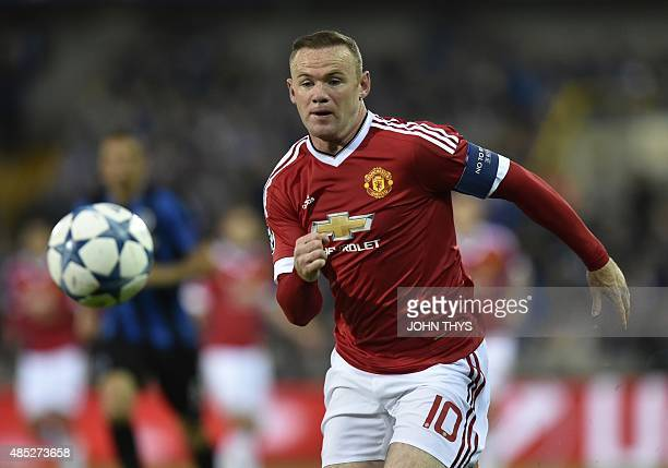 Manchester's Wayne Rooney runs for the ball during the UEFA Champions League playoff round second leg football match between Club Brugge and...