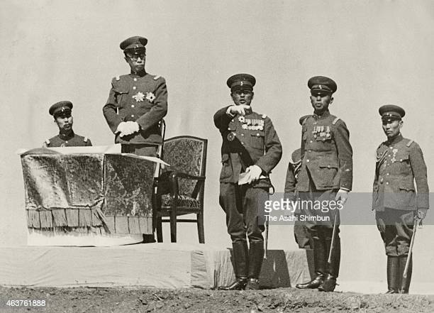 Manchukuo Emperor Puyi receives explanation from school master Tetsujiro Yamada at the military review during the Manchrian Army School graduation...
