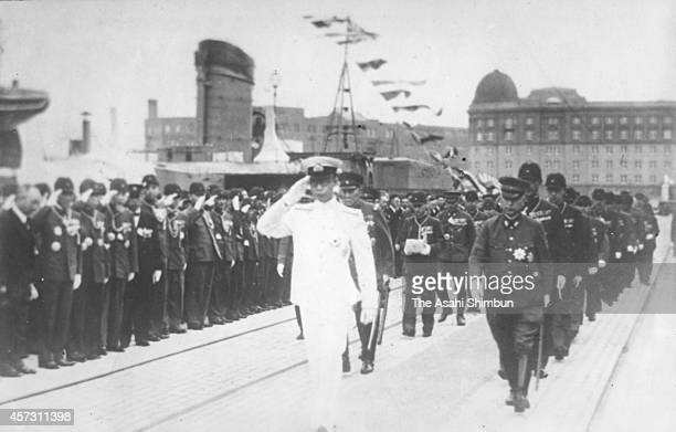 Manchukuo puppet state of Imperial Japan Emperor AisinGioro Puyi or Henry Puyi salutes as he visits Japan on June 26 1940 in Tokyo Japan