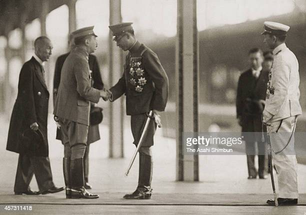Manchukuo puppet state of Imperial Japan Emperor AisinGioro Puyi or Henry Puyi shakes hands with Emperor Hirohito at tokyo Station on June 26 1940 in...
