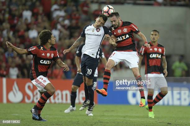 Mancuello of Flamengo battles for the ball with Rubén Botta of San Lorenzo during the match between Flamengo and San Lorenzo as part of Copa...