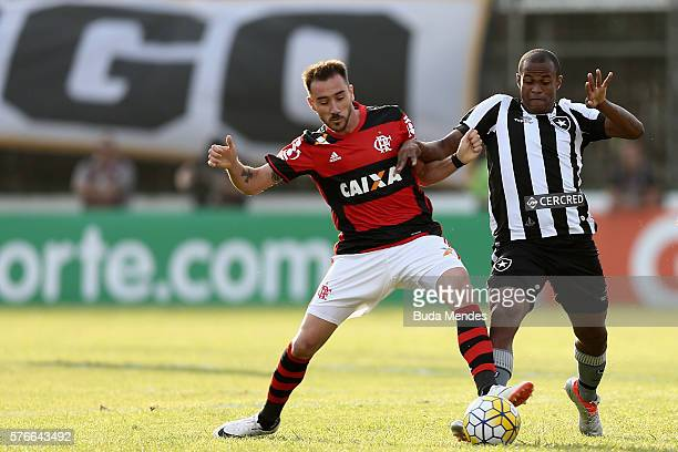 Mancuello of Flamengo struggles for the ball with Airton of Botafogo during a match between Flamengo and Botafogo as part of Brasileirao Series A...