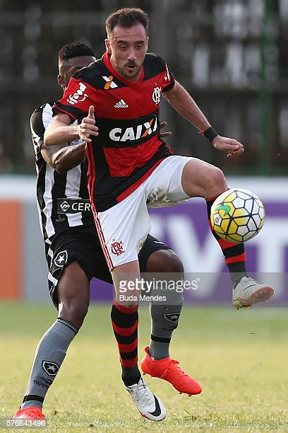 Mancuello of Flamengo struggles for the ball with Emerson of Botafogo during a match between Flamengo and Botafogo as part of Brasileirao Series A...