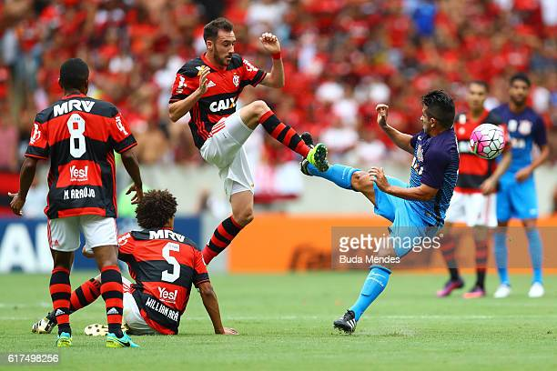 Mancuello of Flamengo struggles for the ball with Guilherme of Corinthians during a match between Flamengo and Corinthians as part of Brasileirao...