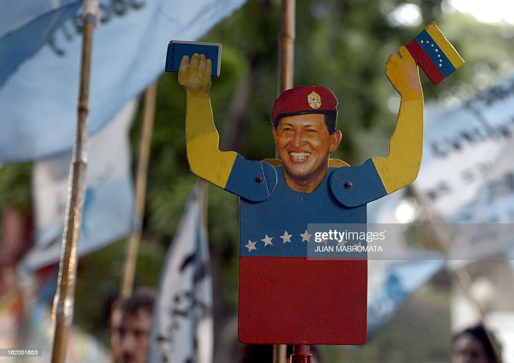 A mand holds a puppet depicting Venezuelan President Hugo Chavez during a demonstration in front of the Venezuelan embassy in Buenos Aires, on February 18, 2013 celebrating his return to Venezuela from Cuba. Chavez returned to Venezuela early on Monday after spending more than two months in Cuba for cancer surgery and treatment, announcing his surprise homecoming via Twitter. 'We have arrived again to the Venezuelan motherland,' Chavez wrote. 'Thank you, God. Thank you, my beloved people. We will continue my treatment here.'AFP PHOTO / Juan Mabromata