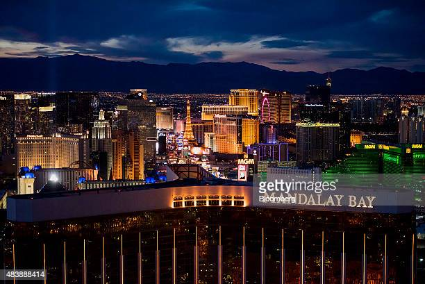 Mandalay Bay Resort And Casino front center and MGM Resorts International Grand Hotel Casino right stand on The Strip in this aerial photograph taken...
