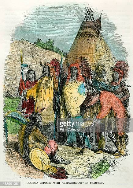 'Mandan Indians with Medicine Man in Bear Skin' c1875 The Mandan traditionally lived along the banks of the Missouri River and two of its tributaries...
