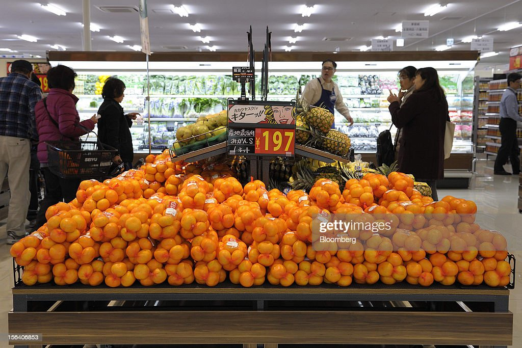 Mandarin oranges are displayed for sale in a Seiyu GK supermarket in Tokyo, Japan, on Wednesday, Nov. 14, 2012. Seiyu GK is a unit of Wal-Mart Stores Inc. Photographer: Akio Kon/Bloomberg via Getty Images