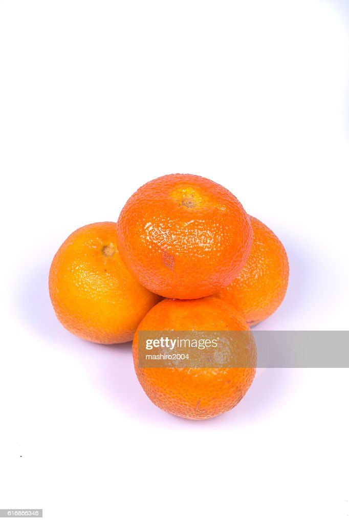 mandarins in the foreground on white background, isolated subject : Stock Photo