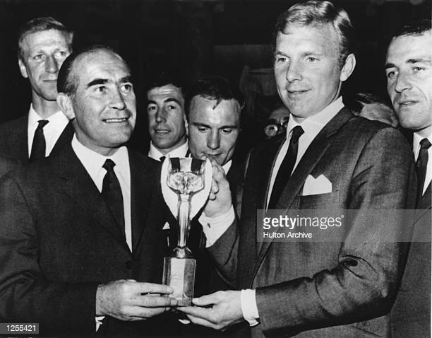 HOLD UP THE JULES RIMET TROPHY AS OTHER ENGLAND PLAYERS LOOK ON DURING A LUNCH RECEPTION AT ITV ELSTREE TELEVISION STUDIOS AFTER ENGLAND WON THE...