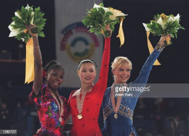 LU CHEN OF CHINA AND NICOLE BOBEK OF USA ON THE MEDAL STAND AFTER THE LADIES FREE SKATING AT THE WORLD FIGURE SKATING CHAMPIONSHIPS AT THE NATIONAL...