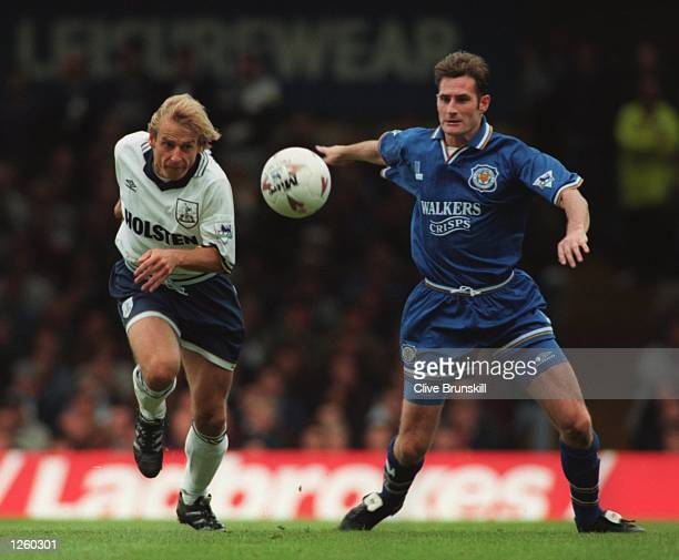 AND JIMMY WILLIS OF LEICESTER CITY IN PURSUIT OF THE BALL DURING THEIR ENGLISH FA PREMIERSHIP MATCH AT FILBERT STREET LEICESTER Mandatory Credit...