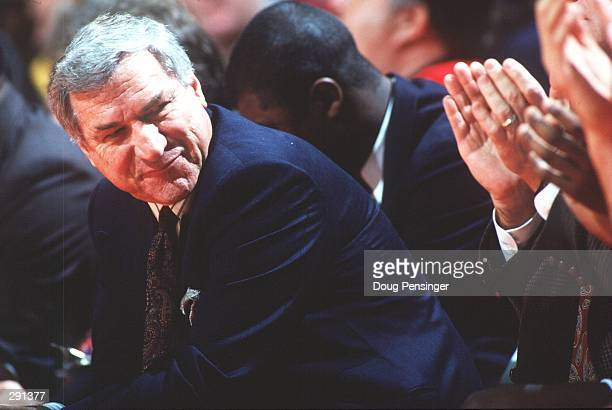 MEN''S BASKETBAL COACH AT THE UNIVERSITY OF NORTH CAROLINA SHARES A MOMENT WITH HIS BENCH DURING THEIR GAME AGAINST THE UNIVERSITY OF MARYLAND...