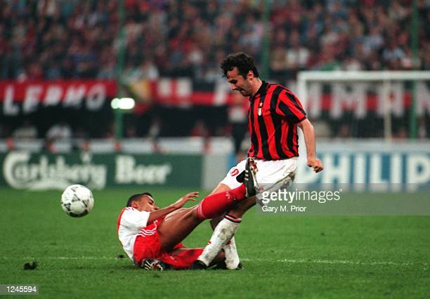 IS CHALLENGED BY LILIAN THURAM OF MONACO DURING THE EUROPEAN CUP SEMIFINAL MATCH IN MILAN ITALY Mandatory Credit Gary M Prior/ALLSPORT