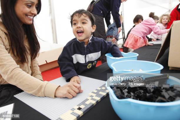 Mandee Lal and her son Jai aged 30 months from Slough arrange some of the last of 48000 Lego bricks to create a mosaic portrait of JK Rowling at...