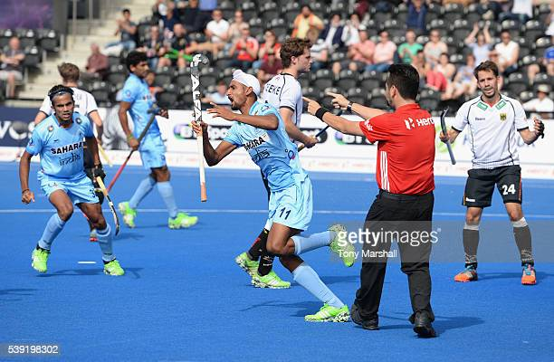 Mandeep Singh of India celebrates scoring their second goal during the FIH Men's Hero Hockey Champions Trophy 2016 Day One match between Germany and...