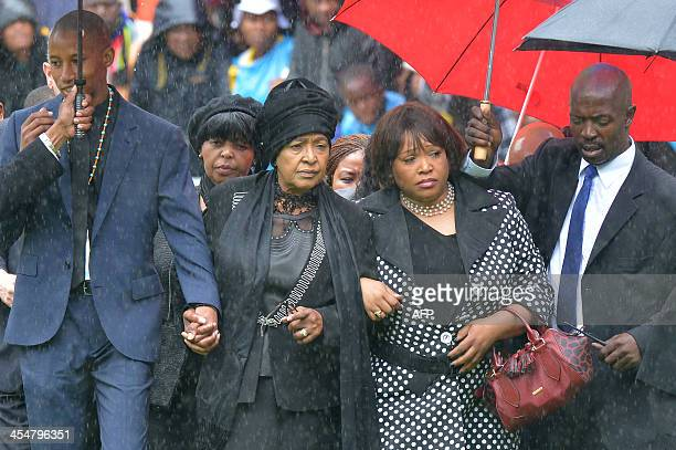 Mandela's former wife Winnie Mandela and daughter Zindzi arrives for South African former president Nelson Mandela's memorial service at the FNB...