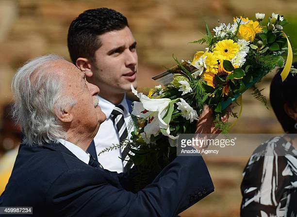 Mandela's lawyer George Bizos leaves a wreath in front of the Mandela's Statue at Freedom Park in Pretoria during the first anniversary of former...