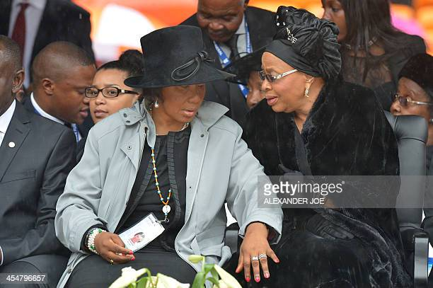 Mandela's widow Graca Machel and her daughter Makaziwe attend the memorial service of South African former president Nelson Mandela at the FNB...