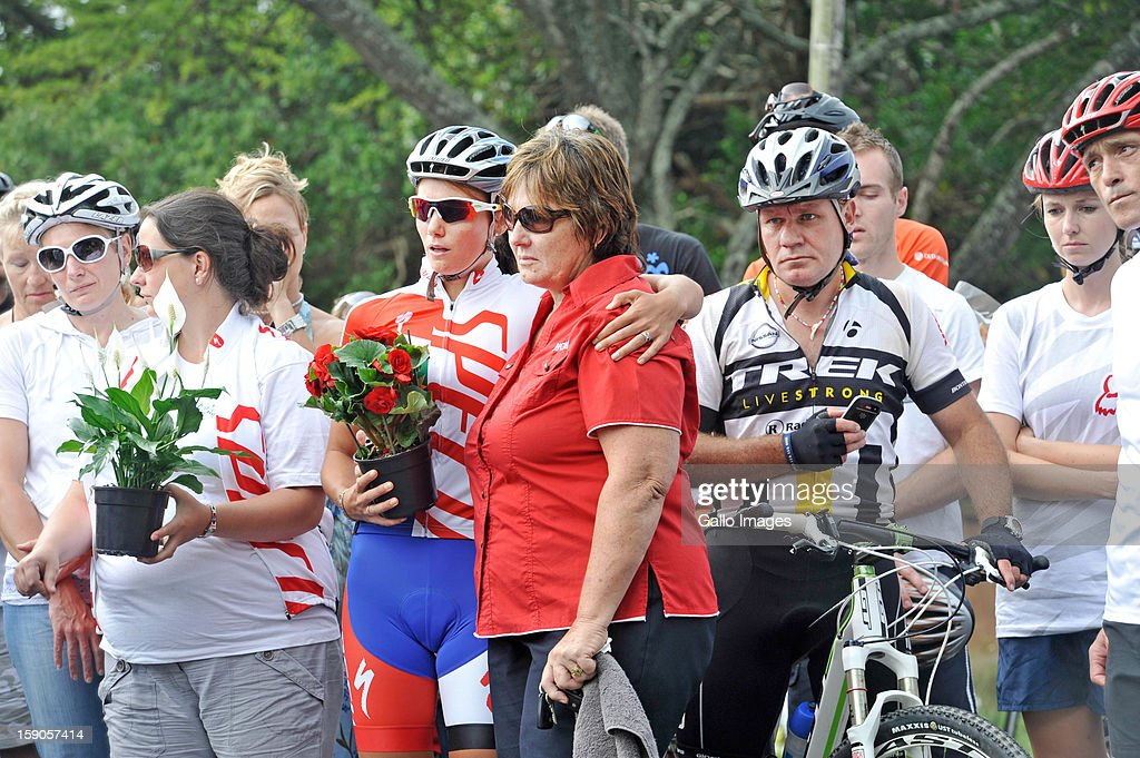 Mandie Stander, Burry's mother and his wife, Cherise Stander, comfort each other at the sight of the accident, where Burry Stander lost his life, on January 6, 2013 in Balito, South Africa. Burry was hit by a taxi while out on a training ride, he suffered severe head trauma and a broken neck, he was killed on impact. The taxi driver has been charged with culpable homicide.