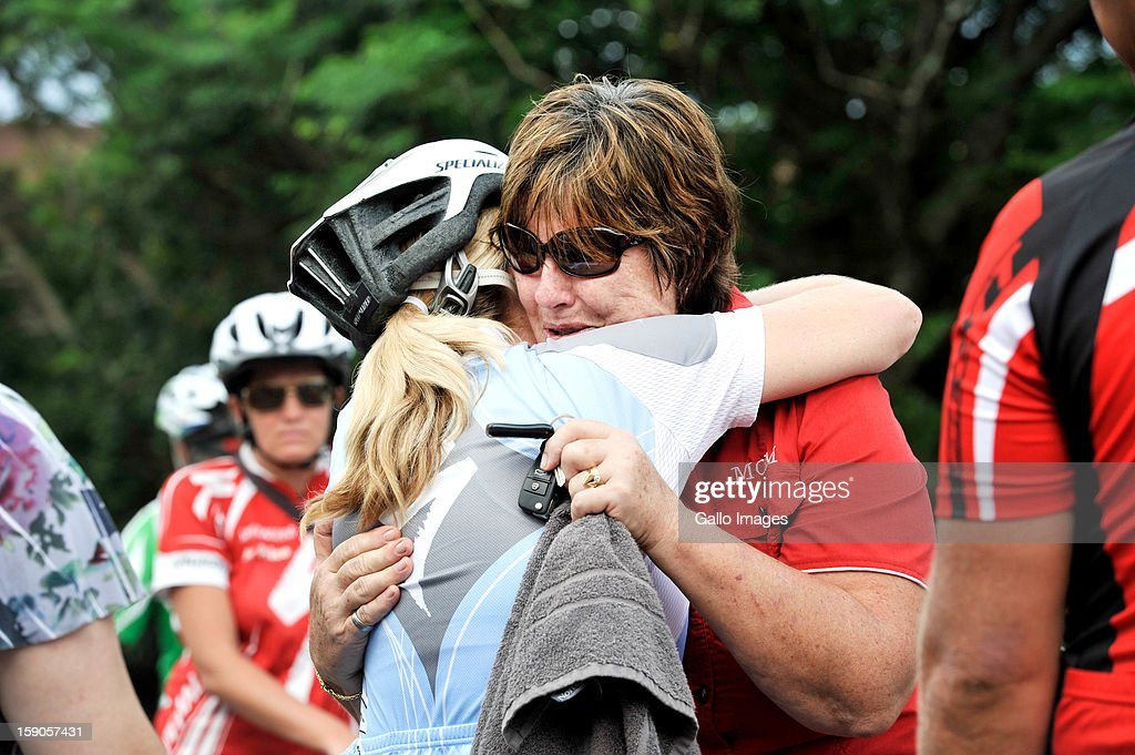 Mandie Stander, Burry's mother, being comforted at the sight of the accident, where Burry Stander lost his life, on January 6, 2013 in Balito, South Africa. Burry was hit by a taxi while out on a training ride, he suffered severe head trauma and a broken neck, he was killed on impact. The taxi driver has been charged with culpable homicide.