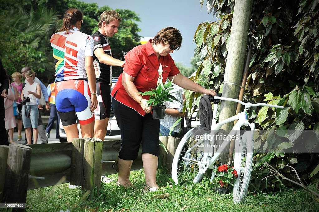 Mandie Stander, mother of the late Burry Stander, lays flowers at the sight of the accident, where Burry Stander lost his life, on January 6, 2013 in Balito, South Africa. Burry was hit by a taxi while out on a training ride, he suffered severe head trauma and a broken neck, he was killed on impact. The taxi driver has been charged with culpable homicide.