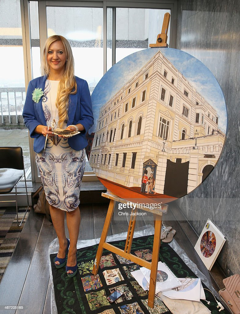 Mandii Pope stands next to her Maori-themed painting of Clarence House as they celebrate success of New Zealand women in the UK on Waitangi day at New Zealand House on February 6, 2014 in London, England. Waitangi Day commemorates the signing of a treaty between 500 Maori Chiefs and the British Crown in 1840.