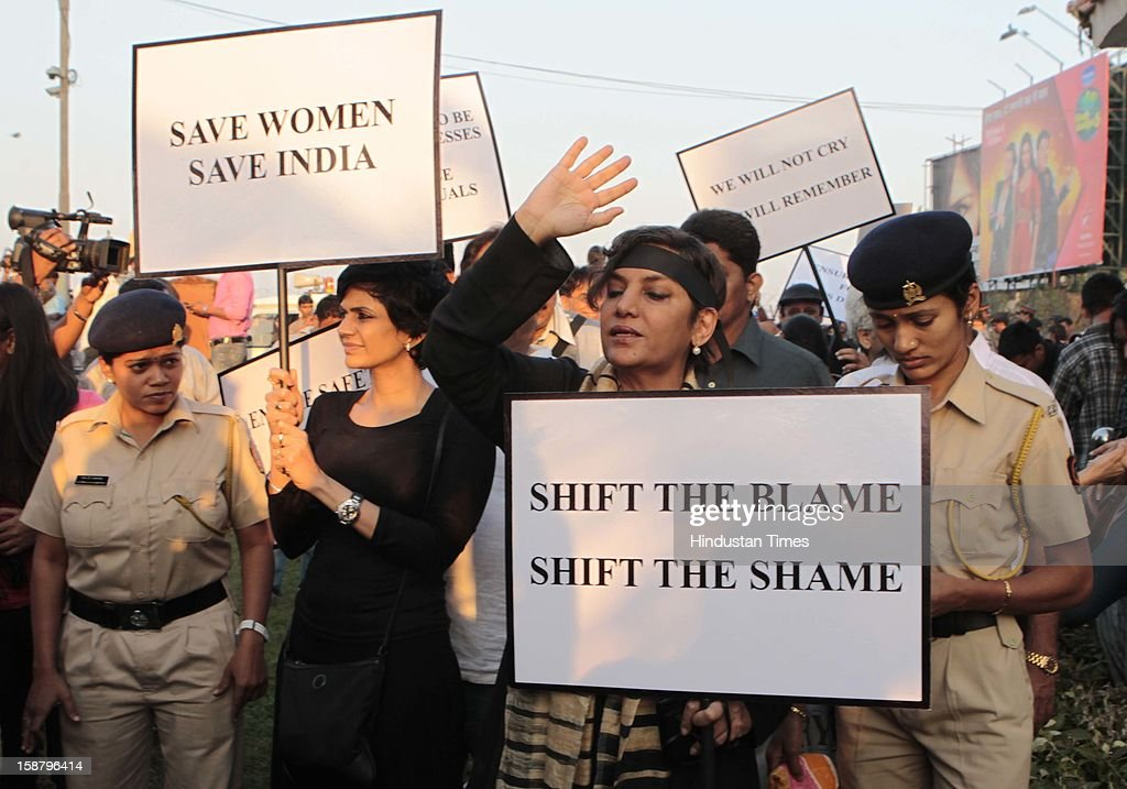 Mandira Bedi and Shabana Azmi during protest by the Bollywood Film Industry against the Delhi rape incident at Juhuon December 29, 2012 in Mumbai, India.The girl died of injuries in Singapore hospital after brutally gang raped in a moving bus on December 16, in Delhi.