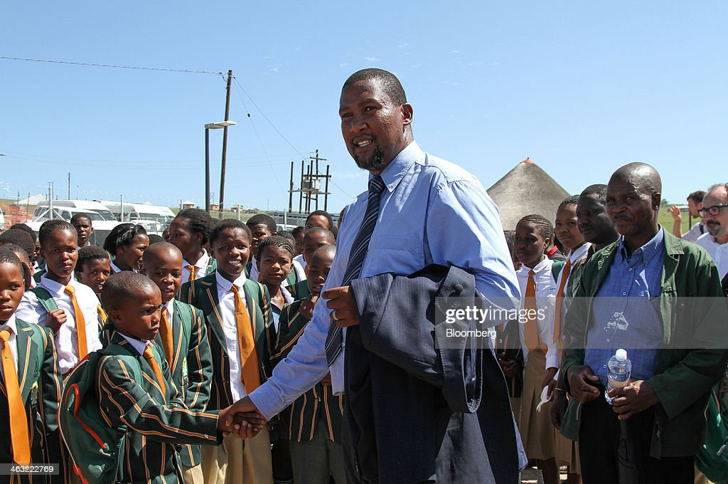 <a gi-track='captionPersonalityLinkClicked' href=/galleries/search?phrase=Mandla+Mandela&family=editorial&specificpeople=5849591 ng-click='$event.stopPropagation()'>Mandla Mandela</a>, local chief and grandson of Nelson Mandela, greets students during a tour of the Mandela School of Science & Technology, funded with a $9 million investment from German engineering company Siemens AG in Mvezo, South Africa, on Thursday, Jan. 16, 2014. While South Africa is forecast to grow 3 percent this year, versus 1.1 percent for the euro-area, its education system was ranked the third-lowest among 148 countries in a survey by the World Economic Forum last year, ahead of only Yemen and Libya. Photographer: Dean Hutton/Bloomberg via Getty Images