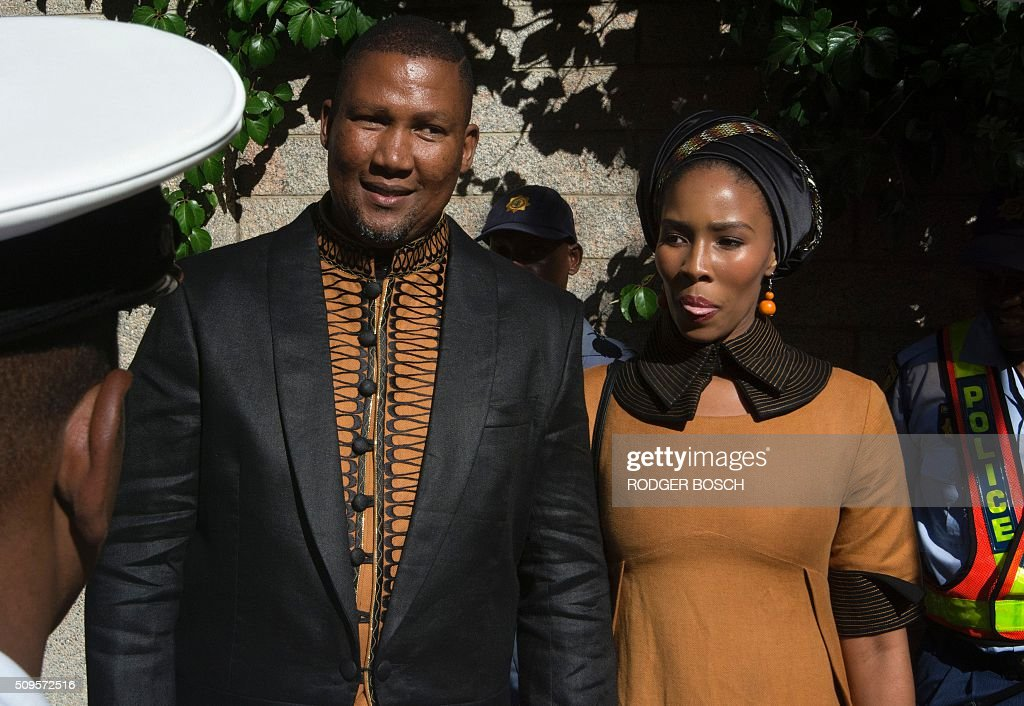 Mandla Mandela, Nelson Mandela's grandson, arrives with his first wife, Tando, both fashionably dressed, for the annual State of the Nation Address (SONA), at the South African Parliament in Cape Town on February 11, 2016. Mandla Mandela has stirred controversy by recently marrying a third wife in a Muslim ceremony. / AFP / RODGER BOSCH