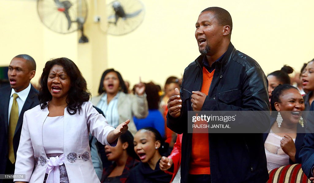 Mandla Mandela, one of former South African President Nelson Mandela's grandsons, attends on July 21, 2013 a church service in Durban as the congregation prays for him and his family and the speedy recovery of Nelson Mandela. Members of Nelson Mandela's family who this month won a court victory in a macabre burial case enjoyed free legal aid because they were deemed to be poor, media reports said on July 21. AFP/PHOTO RAJESH JANTILAL