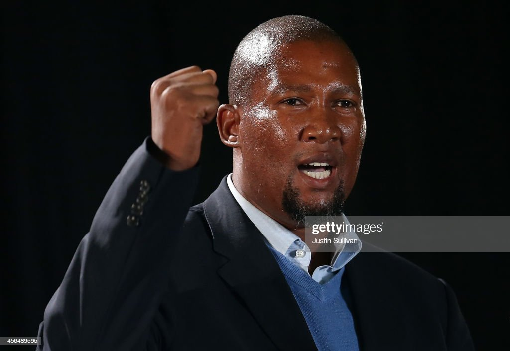 <a gi-track='captionPersonalityLinkClicked' href=/galleries/search?phrase=Mandla+Mandela&family=editorial&specificpeople=5849591 ng-click='$event.stopPropagation()'>Mandla Mandela</a>, the grandson of former South African President Nelson Mandela, speaks during an African National Congress (ANC) led alliance send off ceremony at Waterkloof military airbase on December 14, 2013 in Pretoria, South Africa. The ANC held an official send off ceremony as the body of former South African President prepares to make one final journey to his hometown of Qunu for burial. Mr. Mandela passed away on the evening of December 5, 2013 at his home in Houghton at the age of 95. Mandela became South Africa's first black president in 1994 after spending 27 years in jail for his activism against apartheid in a racially-divided South Africa.