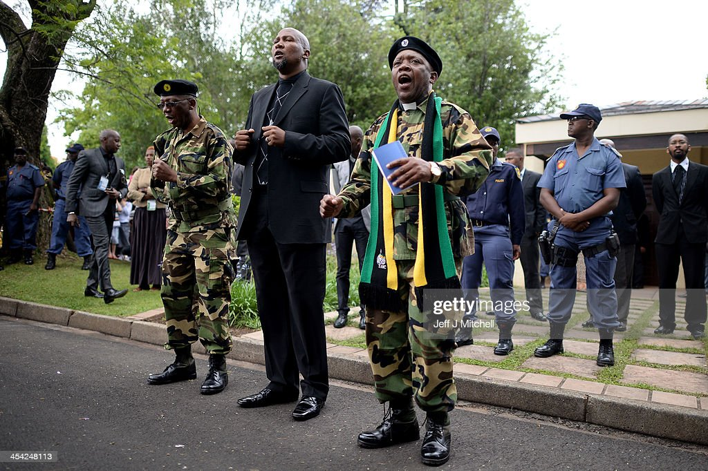 <a gi-track='captionPersonalityLinkClicked' href=/galleries/search?phrase=Mandla+Mandela&family=editorial&specificpeople=5849591 ng-click='$event.stopPropagation()'>Mandla Mandela</a> the grandson of Nelson Mandela prays with MK members outside the former presidents Houghton home on December 8, 2013 in Johannesburg, South Africa. Mandela, also known as Madiba, passed away on the evening of December 5th, 2013 at his home in Houghton at the age of 95. Mandela became South Africa's first black president in 1994 after spending 27 years in jail for his activism against apartheid in a racially-divided South Africa