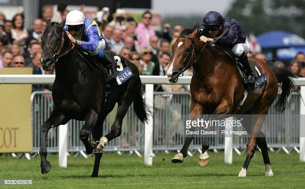 Manduro and jockey Stephane Pasquier heads Dylan Thomas to win the Prince of Wales's Stakes at Ascot Racecourse