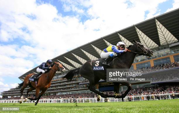 Manduro ridden by Stephane Pasquier heads Dylan Thomas to win the Prince of Wales's Stakes at Ascot Racecourse