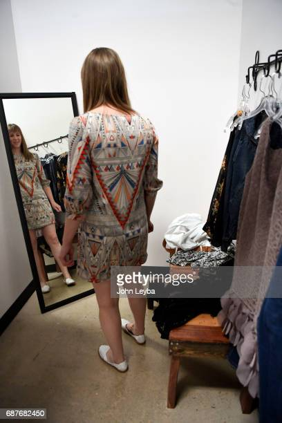 Mandy Anderson check out a dress she picked out as she goes shopping at Peak Thrift store on May 23 2017 Mandy picks out a few items to try on during...