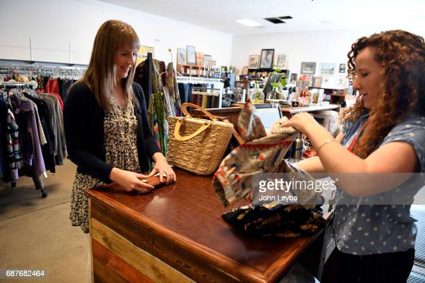 Mandy Anderson purchases a couple of dresses after shopping at Peak Thrift store on May 23 2017 Mandy picks out a few items to try on during her...