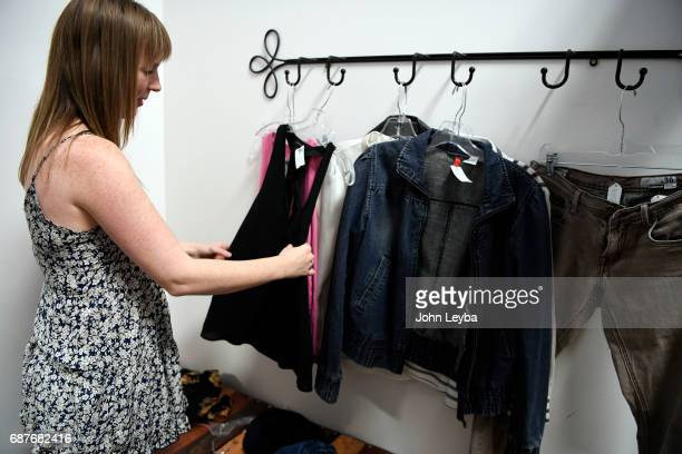 Mandy Anderson sorts through some clothes she's tried on as she goes shopping at Peak Thrift store on May 23 2017 Mandy picks out a few items to try...
