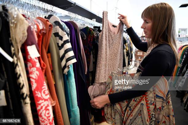 Mandy Anderson sorts through some dresses to try on as she goes shopping at Peak Thrift store on May 23 2017 Mandy picks out a few items to try on...