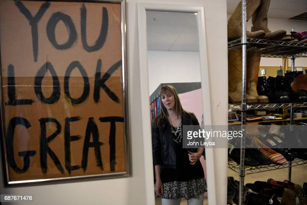 Mandy Anderson tries on a jacket as she goes shopping at Peak Thrift store on May 23 2017 Mandy picks out a few items to try on during her shopping...