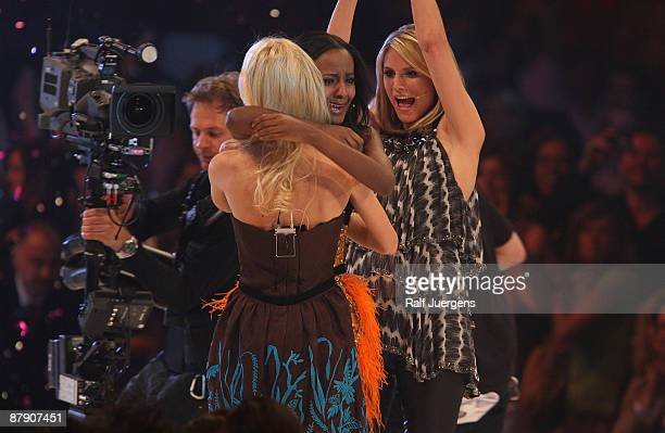 Mandy Bork and Heidi Klum congratulate Sara Nuru after she won the PRO7 TV show 'Germany's Next Topmodel Final' at the Lanxess Arena on May 21 2009...