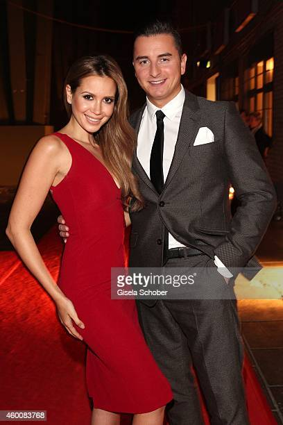 Mandy Capristo and Andreas Gabalier attends the Ein Herz fuer Kinder Gala 2014 at Tempelhof Airport on December 6 2014 in Berlin Germany