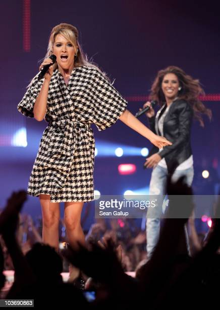 Mandy Capristo and Senna Guemmour of the German girl band Monrose perform at The Dome 55 on August 27 2010 in Hannover Germany
