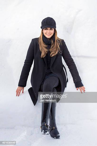 Mandy Capristo one of four judges of the german TVshow DSDS poses in front of a snow sculpture on January 16 2015 in Ischgl Austria